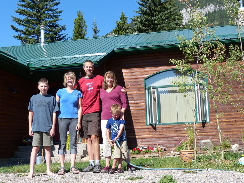 Nick, Karen, and the Sparks family in front of our hosts' home in Crowsnest Pass. Quinn could only be coaxed into the picture if he was allowed to bring the hose.