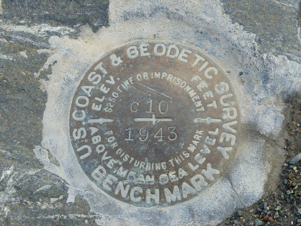 A US geological survey marker installed in the middle of Canada during construction of the AK Highway