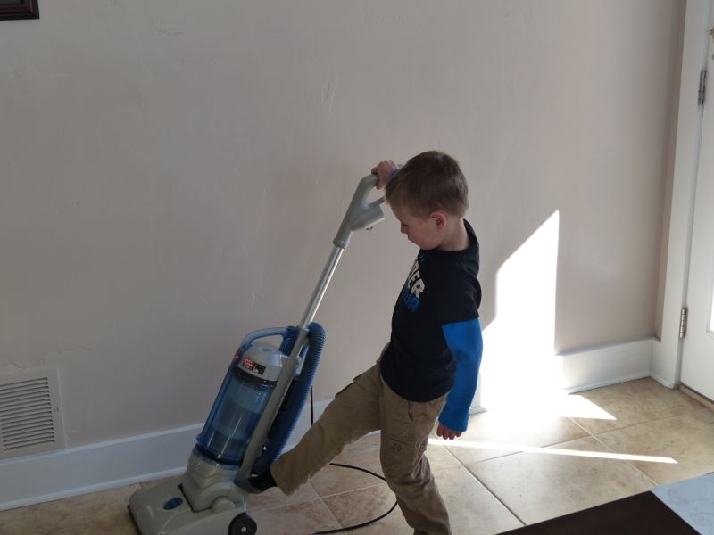 Quinn makes sure Grammy and Papa's house is nice and clean before we leave.