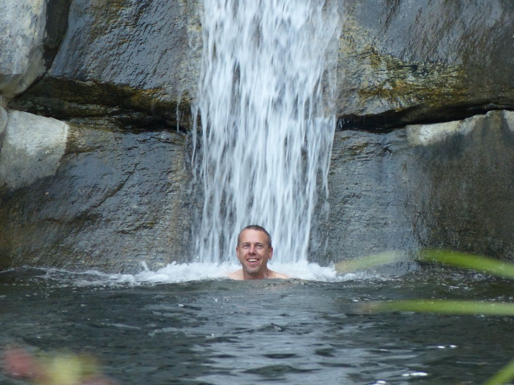 The water coming down the waterfall was much warmer than the water in the pool.