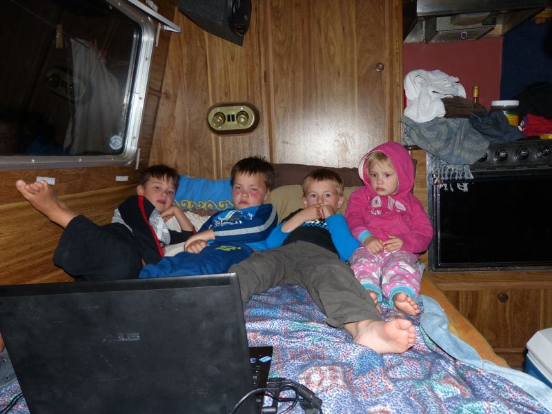 The kids enjoy a movie on our friends' camper
