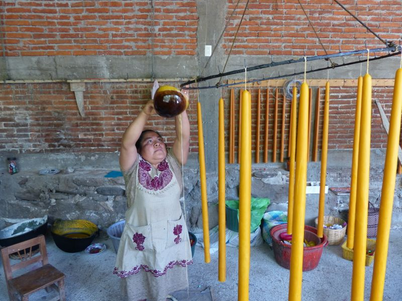 The ladies in the candle shop were making candles for Easter. They started by hanging a long string, then pouring hot wax down it over and over. They said it takes about 100 pours to make a candle.