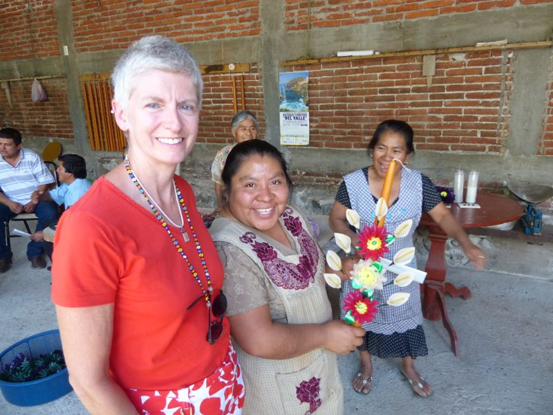 Then they make wax flowers and pin them to the candle. Leanne, our hostess at Overlander Oasis, is on the left.
