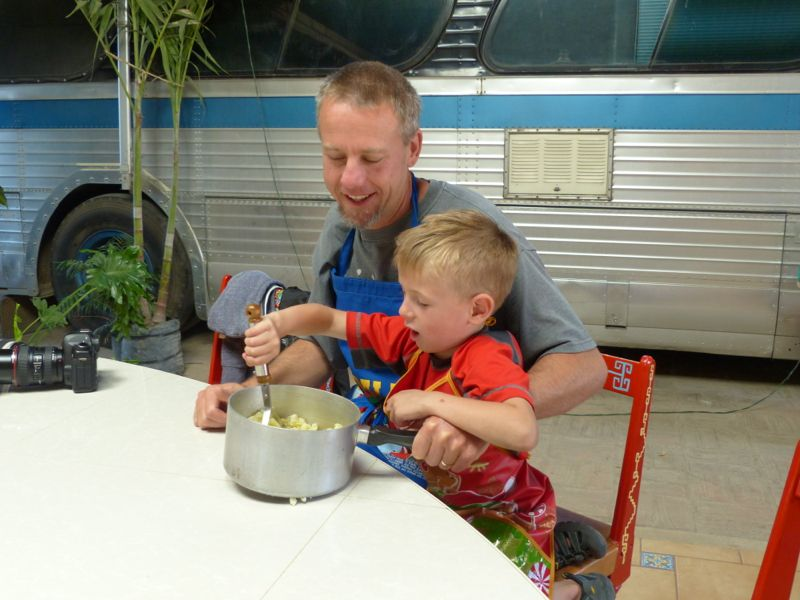 Quinn and dad mash potatoes. We added chorizo sausage to the potatoes to make the filling for the moletos