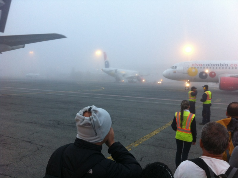 Our flight from Medellin to Cartagena left at 6am. It being a budget airline, we got to walk about a kilometer across the tarmac in cold fog to reach our plane.
