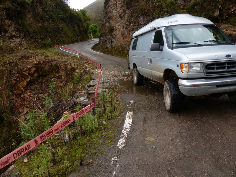Traversing a crumbling section of road.