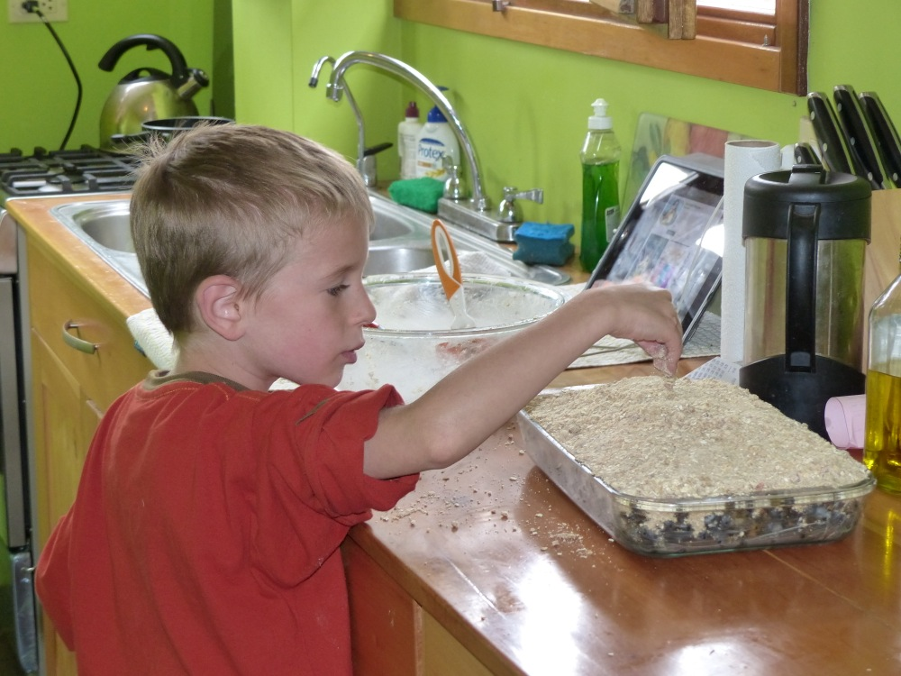 Putting the finishing touches on another yummy blueberry crisp.