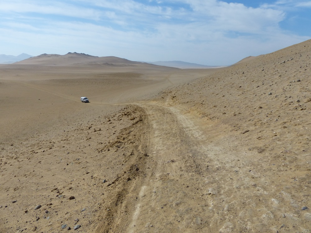 """At some point we lost the """"main"""" road and followed tracks through the desert for awhile before getting back on track with the help of the GPS."""
