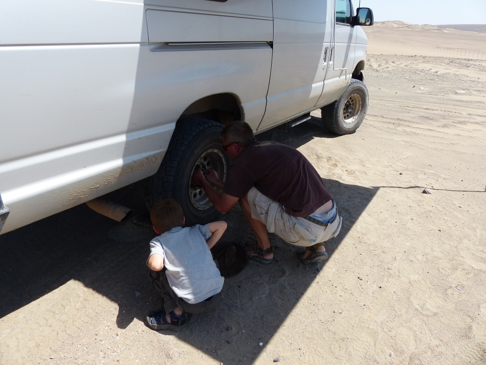 Jen set up the awning so we'd have some shade to work under, and Quinn helped me change the tire.
