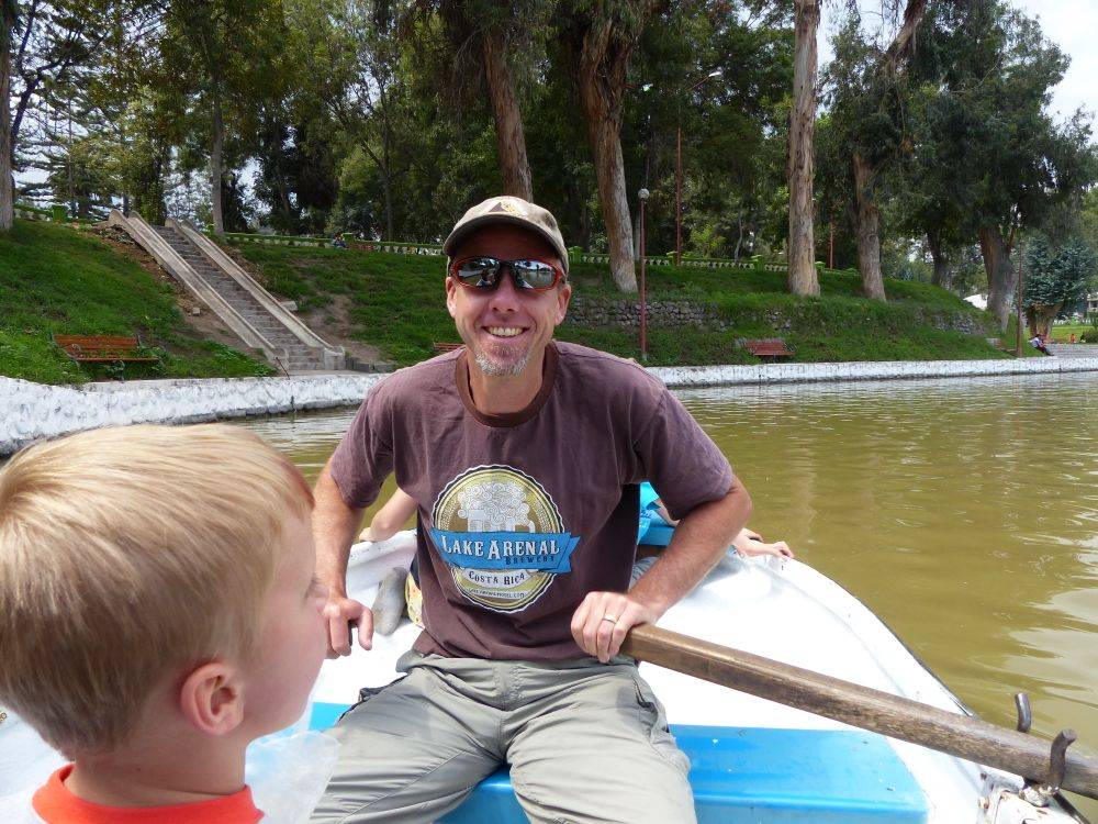 We rented a boat and paddled around the duck pond in the park.
