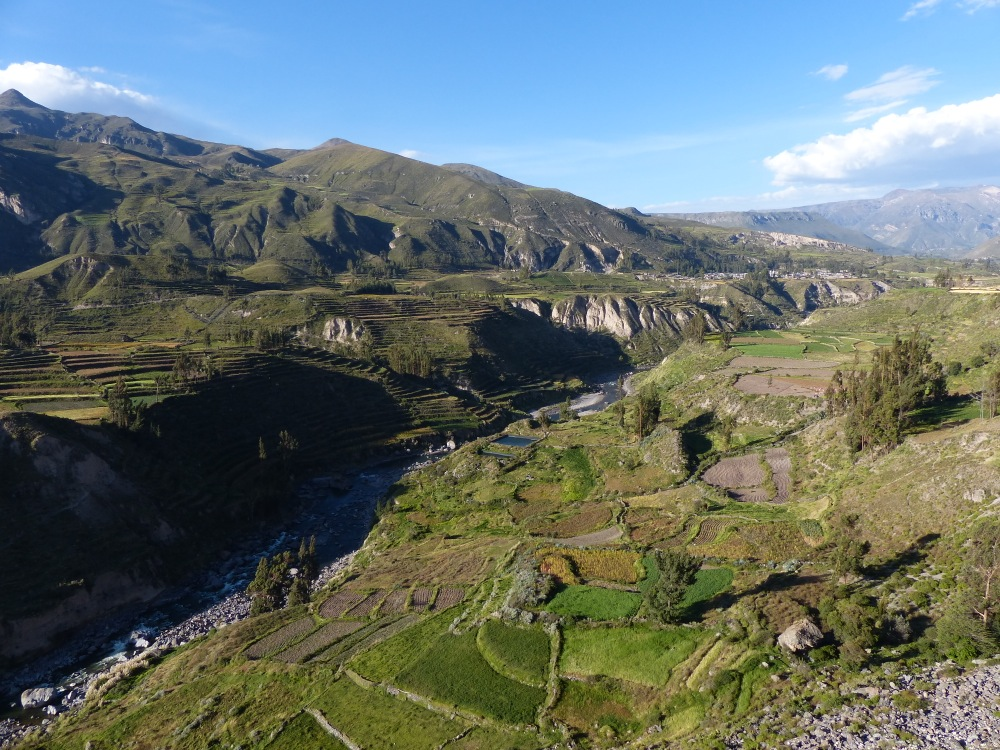 The canyon features thousand year old terraces overlooked by snow-capped peaks.