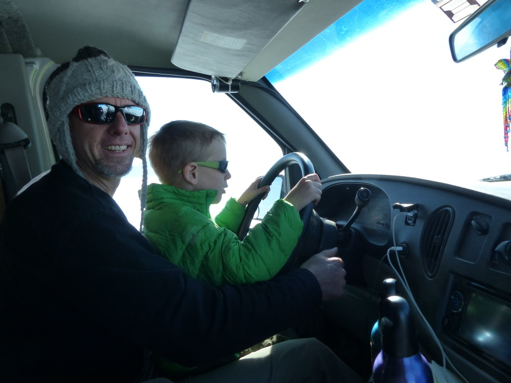 Q gets his first driving lesson. We got the van up to 80mph out here!