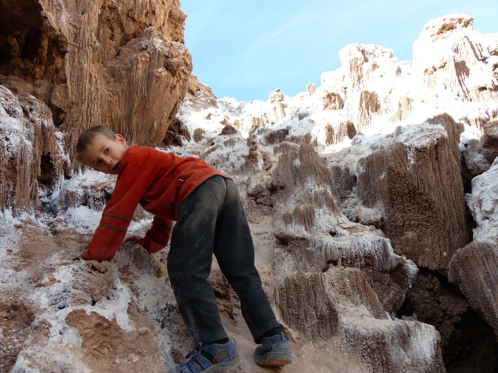 Quinn had a good time climbing on the strange salt formations.