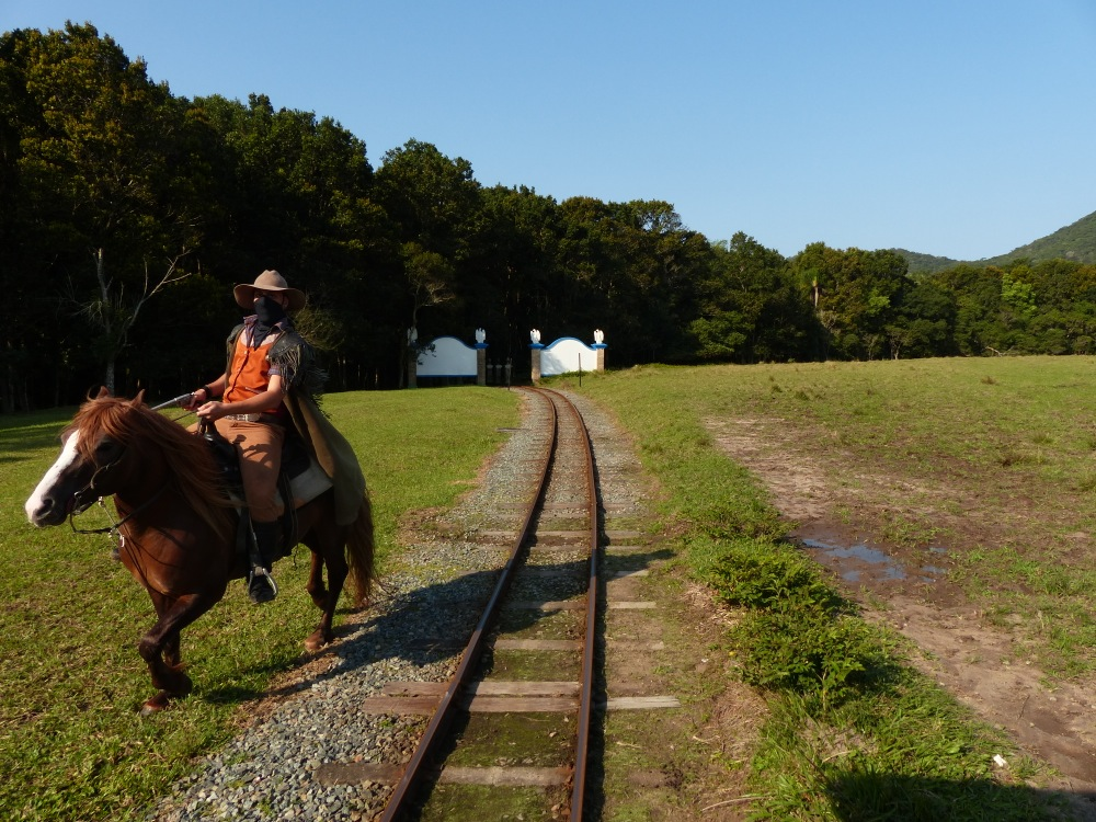 At one point the train stopped and a couple of gauchos rode up on horseback to rob the train!