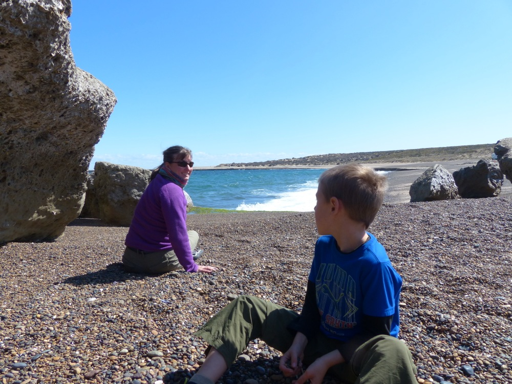 We found a great pebble beach near our campsite that was sheltered from the cold wind. The rocks would get warm in the sun and it made a great place to play.