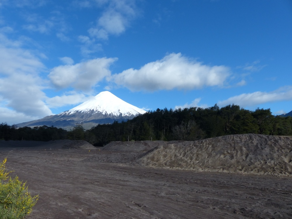 The view of Volcán Osorno from our campsite in Petrohué. The piles of sand in the foreground are actually volcanic ash.