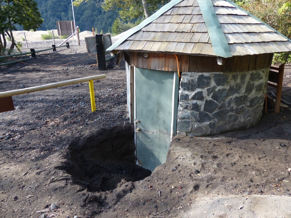 A different volcano erupted in April, covering the area with over two feet of ash. This is one building that hasn't yet been dug out.
