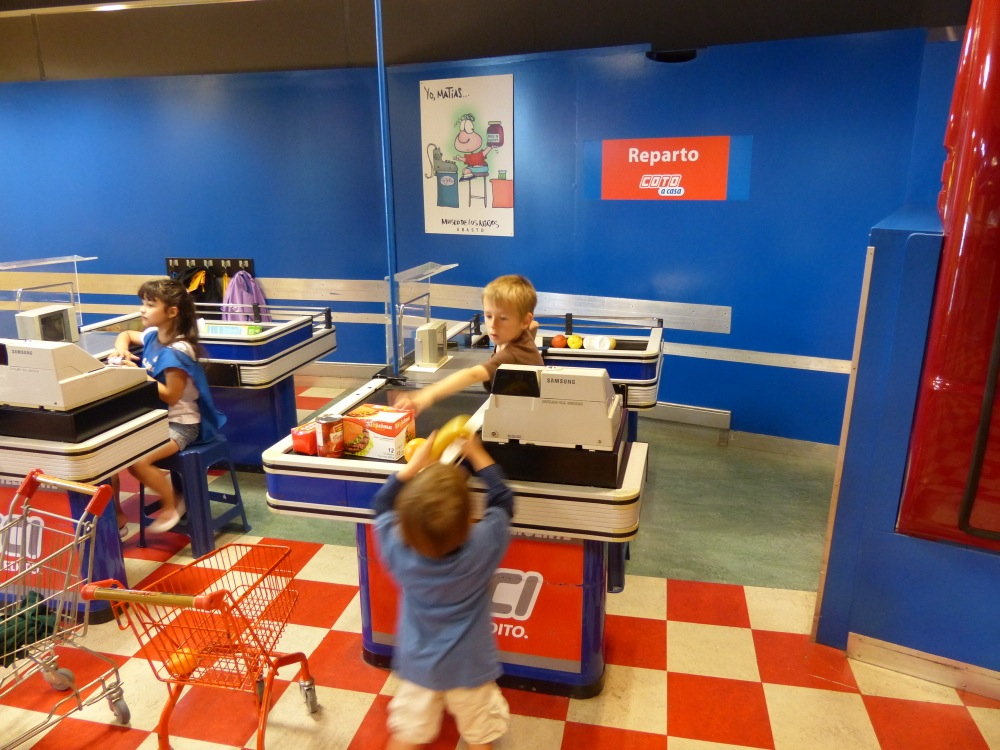 We visited a couple of children's museums in Buenos Aires. Quinn learns to be a checker at a grocery store.
