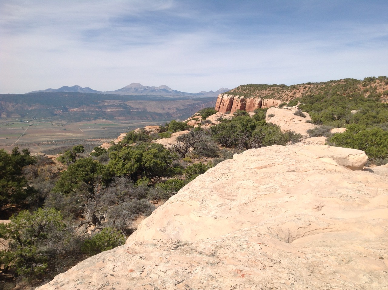 Views into the Paradox Valley with the La Sal mountains in the background make the climb worthwhile.